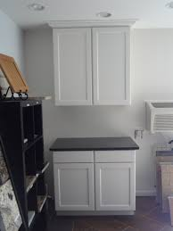 diy unfinished oak kitchen cabinet painted with white color for small kitchen spaces with black marble countertop ideas