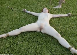 Spread eagle naked outdoors