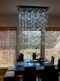 chandelier installation quatro team modern dining room for amazing property dining room modern chandeliers designs