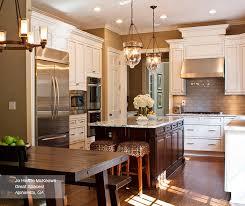 Off white kitchens Cream Off White Glazed Cabinets With Dark Kitchen Island Kitchen Craft Off White Glazed Cabinets And Dark Kitchen Island Kitchen Craft