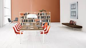 white eames shell chairs with orange upholstery at a layout studio bench in an open studio furniture layout o66 layout