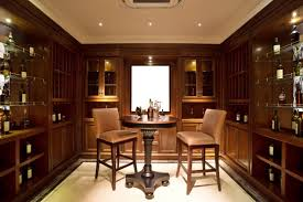 wine tasting room furniture. custom wine storage cabinets form the walls of this tasting room with an intimate table furniture