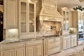 view larger image kitchen with wood vent hood and glass panel cabinet doors in paint grade maple