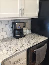 white ice granite countertop white subway tile with gray grout