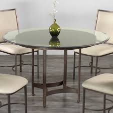 tucson round glass dining table by wesley allen shown in aged steel