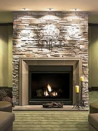 fireplace mantel lighting ideas. Breathtaking Ideas For Mantel Decor Features Stacked Stone Fireplace And Metal Art Candlesticks Recessed Ceiling Lights Lighting F