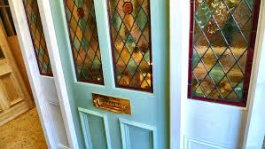 a stained glass front door with frame and sidelights the pictures to show larger views