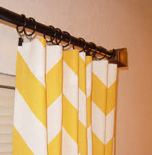beautiful chevron curtains for curtains inspiration yellows chevron curtains with brown wood finial