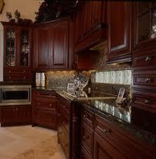 cherry kitchen cabinets black granite. cherry wood cabinets and dark granite tops kitchen black