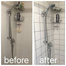regrouting with dark grey grout to modernise a boring shower working with cur square tiles and adding on in shower