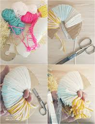 How to make a giant, yarn pom pom garland   MyFabulessLife.com