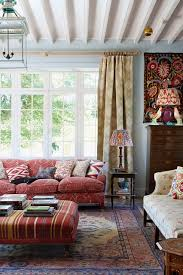 red sofas in living room. blue living room with antique textiles in country style rooms. french red sofas p
