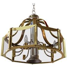 fredrick ramond chandelier with glass panels in brass and chrome