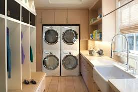 double stack washer and dryer. Double Stack Washer And Dryer With Traditional Household Cleaning Products Laundry Room Light