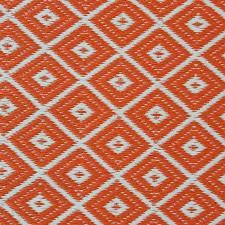 aztec outdoor rug in orange white front close up