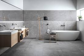 soft matt stone look floor tiles pair with geometric wall tiles both from refin s grecale collection to create this superb minimalist bathroom