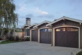 garage home gyms garage farmhouse with wood garage doors gooseneck outdoor lighting gooseneck outdoor lighting