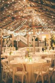 rustic wedding lighting. we love the intimate warmth of this wedding reception thanks to twinkling lights featured rustic lighting