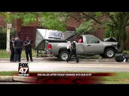 Man dies after being hit by pickup truck at bus stop - YouTube