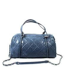Chanel Metallic Blue Leather Quilted Duffel Bag – Encore Consignment & Chanel Metallic Blue Leather Quilted Duffel Bag Adamdwight.com