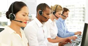 office centre video. call centre agents working with one smiling at camera the office 4k stock footage video e