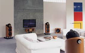 living room lcd tv on grey wall panel connected by white fabric chair on the