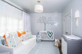 orange and gray boy nursery with slipcovered daybed