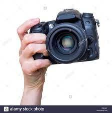 Weibliche hand mit modernen DSLR-Kamera mit Objektiv montiert. Fotografie  Ausrüstung. Auf weiß isoliert Stockfotografie - Alamy