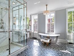here a graphic black and white basketweave makes this classic bathroom go from basic to beautiful and that small mosaic makes the room look larger when