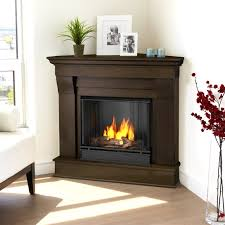 corner gas fireplace with laminate flooring and glass floor vas and sofa