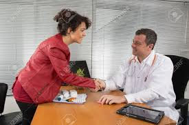 doctor receiving a w pharmaceutical s representative stock doctor receiving a w pharmaceutical s representative stock photo 38064836