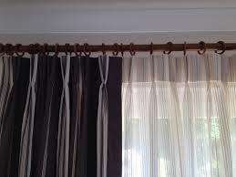 Curtains and voiles finished by hand featuring a double pinch ...