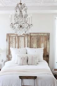 bedroom elegant scandinavian bedroom decor with rustic wood headboard also chic crystal chandelier also white