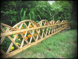 vegetables garden fence ideas for protection. Excellent Home Garden Design Featuring Yellow Orange Flowers Protected With Custom Bamboo Fence Awesome Backyard Green Vegetables Ideas For Protection