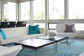 rugs living room nice: amusing modern white living sofas and black square small desk on rug and open glass windowed