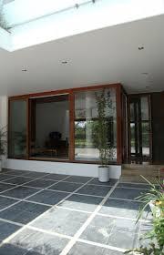 asian rectangular house with small courtyard housebeauty for modern car porch tiles design