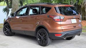 ford escape 2017 black. the standard crossover lower black accent starts with \u201cskid plate\u201d under new grill, then flows around rounded fender flares and upward-angled ford escape 2017