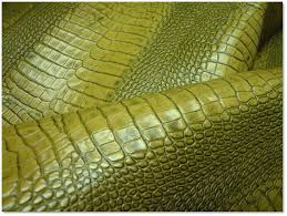 corrected grain leather is almost always embossed but full grain leather can be embossed as well