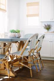 weathered concrete top dining table with french bistro chairs