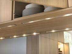 under the counter lighting. Wonderful Lighting White Plates Beautiful Modern Light Wooden Kitchen Cabinet Under Counter  Lighting Idea For The L
