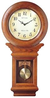 light oak wall clock river city clocks chiming regulator wall clock with swinging pendulum and oak