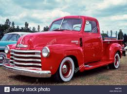 1950 Chevrolet stepside pick up truck in bright red Stock Photo ...