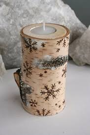 View in gallery Birch wood candle holder with snowflake designs