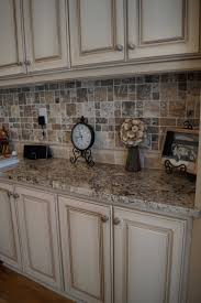 Refinished White Cabinets 25 Best Ideas About Antiqued Kitchen Cabinets On Pinterest
