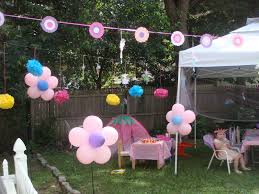 decoration: Pink Flower Shape Balloon On Green Grass Near Wooden Fence  Closed Cute Tent And