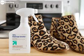 a pair of cheetah print boots sitting on a counter in a kitchen next to