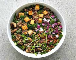 just a little over 500 calories for this warm bowl that includes organic quinoa farro swiss chard pea shoots roasted mushrooms red onion