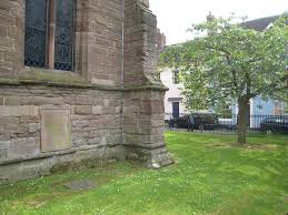 to an athlete dying young a e housman writework housman s grave at st laurence s church in ludlow shrophire england note the