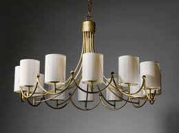 royere inspired wrought iron 12 light chandelier in distressed gold leaf finish with cream silk shades