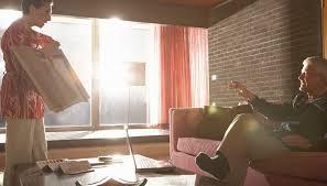 Mature couple looking at designs in living room. Interior decorators choose  furniture ...
